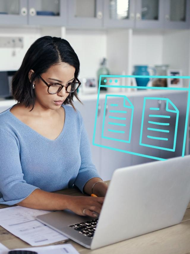 woman managing documents on laptop