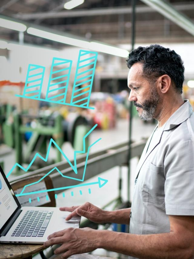 man viewing manufacturing analytics